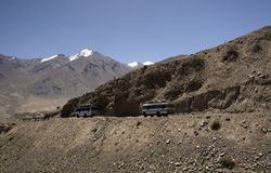 Public buses running in the rugged and dangerous road. Public buses are taken by the locals to travel around Ladakh which ply in the most dangerous road stock photography