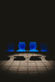 Public chair in the dark. Royalty Free Stock Images
