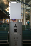 Public charging station socket nobody. Electrical socket for digital devices airport Royalty Free Stock Photos