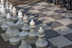 Public chess games in Bastions Park, Geneva. The main entrance to Bastions Park is from Place Neuve. Just behind the big decorated gate are huge black-white Royalty Free Stock Image