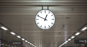 Public circle clock In a railway station with roof, Black and white classical public hanging clock,The main railway station. Clock at the subway train station royalty free stock images