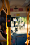 Public city bus transport. Inside public city bus transport and stop button detail Royalty Free Stock Images