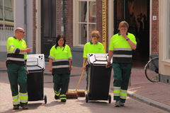 Public cleaning service at work. Four members of the public cleaning service walking down the street of the dutch city zwolle, the netherlands. Taken on 11-2 stock photography