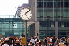 A public clock in Reuters Plaza packed with people Royalty Free Stock Image