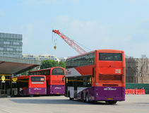 Public commuter buses at a busy bus terminal Royalty Free Stock Images