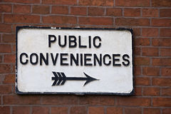 Public convenience sign. On outside wall in a typical English village Royalty Free Stock Images