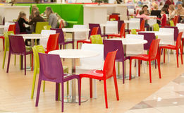 Public dining area with colourul plastic chairs and tables Stock Image