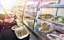 Public dining counter. With food royalty free stock image