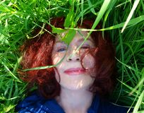 PUBLIC DOMAIN DEDICATION Pixabay-Pexels digionbew 14. 04-08-16 Photographer lying back in the grass LOW RES DSC07781 Stock Image