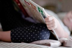 Public Domain- Little Girl Reading Book Bedtime Nap Stock Photos