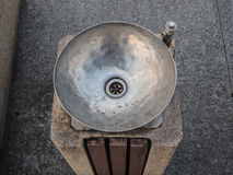 Public drinking water faucet, drink dispenser in public park Royalty Free Stock Photo