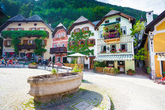 Public drinking water fountain with typical colorful houses in H Royalty Free Stock Image