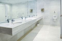 Public empty men restroom with washstands mirror Royalty Free Stock Image