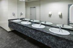 Public empty restroom Stock Images