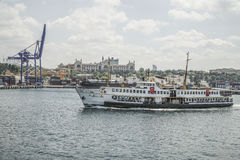 Public ferry passes Cargo Port in Istanbul, Turkey. Royalty Free Stock Photo
