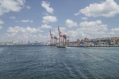 Public ferry passes Cargo Port in Istanbul, Turkey. Stock Photos