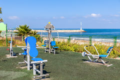 Public fitness equipment on promenade. Royalty Free Stock Images