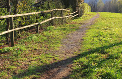 Public footpath, meadow and wooden fence Stock Images