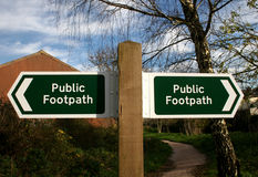 Public footpath sign. Pointing direction of path Stock Images