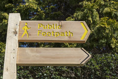 Public Footpath Sign. Against green foliage Stock Photos