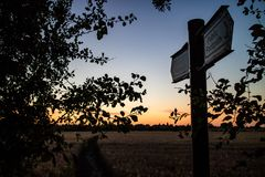 Public Footpath sign at dusk. A public footpath sign in wheat fields in the Lincolnshire countryside. Taken at dusk Stock Photos