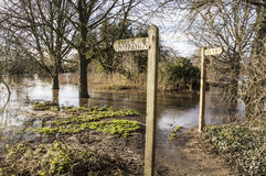 Public footpath sign, with flooded pathway Stock Photos