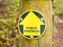 A public footpath sign in the forest leading the way on a trail. In spring while walking Stock Photography