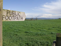 Public footpath sign pointing towards field Royalty Free Stock Images