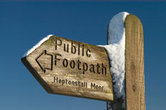Public Footpath Sign. In the snow on a clear sunny day Royalty Free Stock Photography