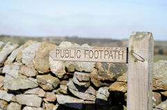 Public Footpath Signpost. In front of a dry stone wall Stock Images