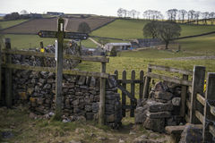 Public footpath signposts in landscape in Peak District UK on su Royalty Free Stock Photography