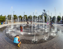 In the public fountain area have a refreshing bath Stock Image