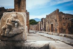 Public fountain with hercules that kills the lion in the streets of Pompeii Stock Image