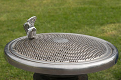 Public free drinking fountain tap, water bubbler, provided at th Stock Photography