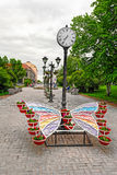 Public garden alley. SORTAVALA, RUSSIA - MAY 28, 2016: Public garden with a city clock and a decorative flower bed in Sortavala, Republic of Karelia, Russia royalty free stock photos