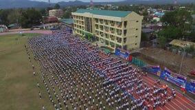 Public grade school pupils prepare for Calisthenics dance. drone aerial. San Pablo City, Laguna, Philippines - February 25, 2018: Public elementary grade school stock video footage