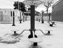 Public gymnasium. With diverse machines to do exercise in the street. Image in white and black Royalty Free Stock Photo