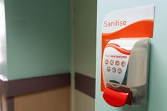 Public hand disinfectant sanitizer dispenser available in hospit stock images