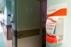 Public hand disinfectant sanitizer dispenser available in hospital for hygiene. Purpose stock images