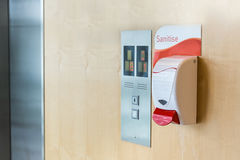Public hand sanitizer next to elevator Stock Photography
