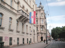 Public  holiday in Zagreb. An almost empty street in dowtown Zagreb on a public holiday. Croatian flag displayed from the balcony of a building Royalty Free Stock Image