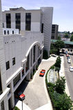 Public Hosptial. Modern building – public hospital with street and driveway stock image