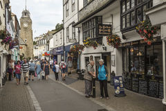 Public houses and shops in Looe with clock tower. Royalty Free Stock Photo