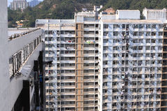 Public housing estate. A public housing estate is a housing estate in Hong Kong mainly built by the Hong Kong Housing Authority and the Hong Kong Housing Society stock photography