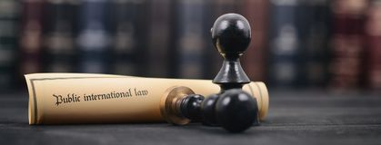 Public international law, Notary seals and Law books . Law and Justice, Legality concept, Notary seals, Public international lawl on a wooden background, Law Stock Photography