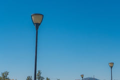 3 public lamps erecting to the sky. Royalty Free Stock Image