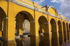 Public Laundry Fountain Yellow Arches Spanish Colonial Style Architecture Old City Antigua Guatemala royalty free stock photo
