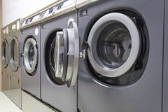 Public laundry. Industrial Washing in public shop, business and laundry Royalty Free Stock Photography