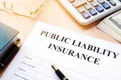 Public liability insurance policy on a desk. Public liability insurance policy on an office desk Stock Photos