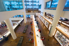 Public library of Amsterdam. AMSTERDAM - AUGUST 26: People visit the city's public library on August 26, 2014 in Amsterdam Royalty Free Stock Image